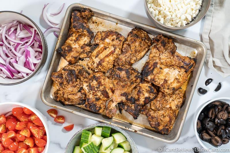 Chicken on tray for Greek Chicken Bowl Recipe