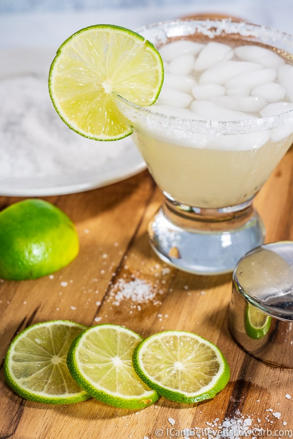Keto Margarita in a glass with salt rim and limes