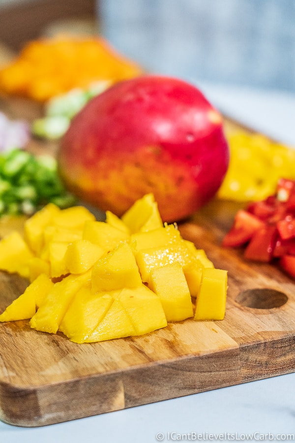 making Low Carb Mango Salsa Recipe on cutting board