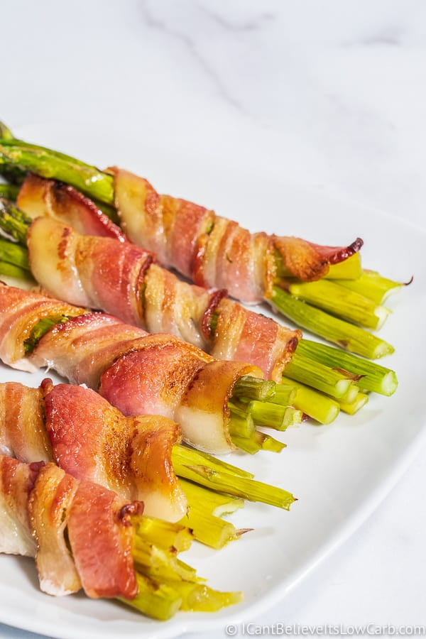 cooked Bacon Wrapped Asparagus on plate