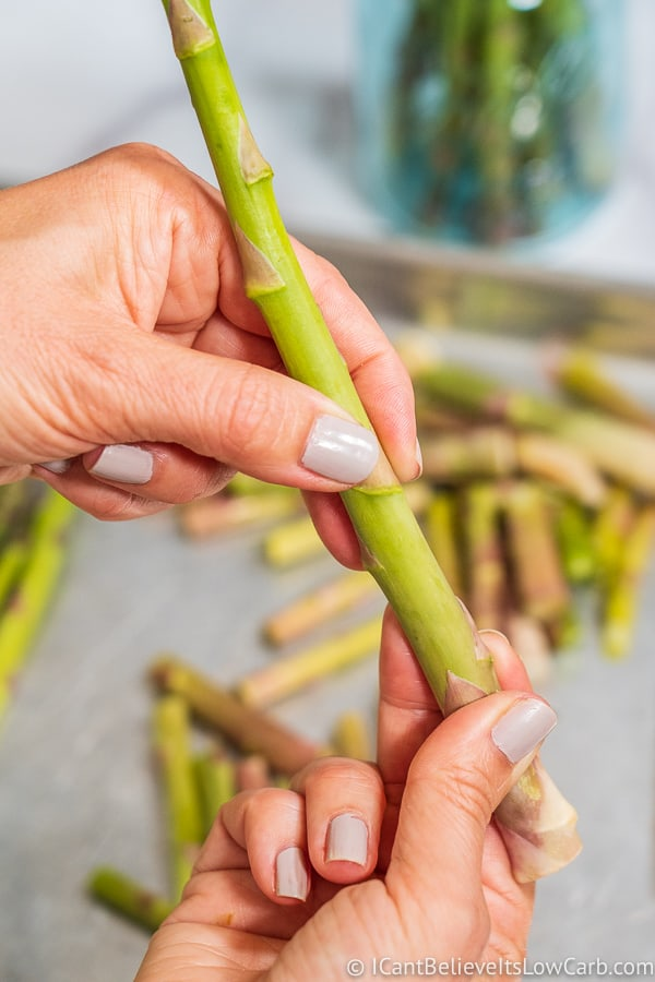 snapping asparagus stalks