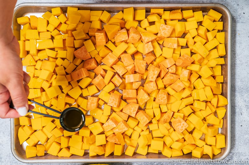 pouring oil on Butternut Squash