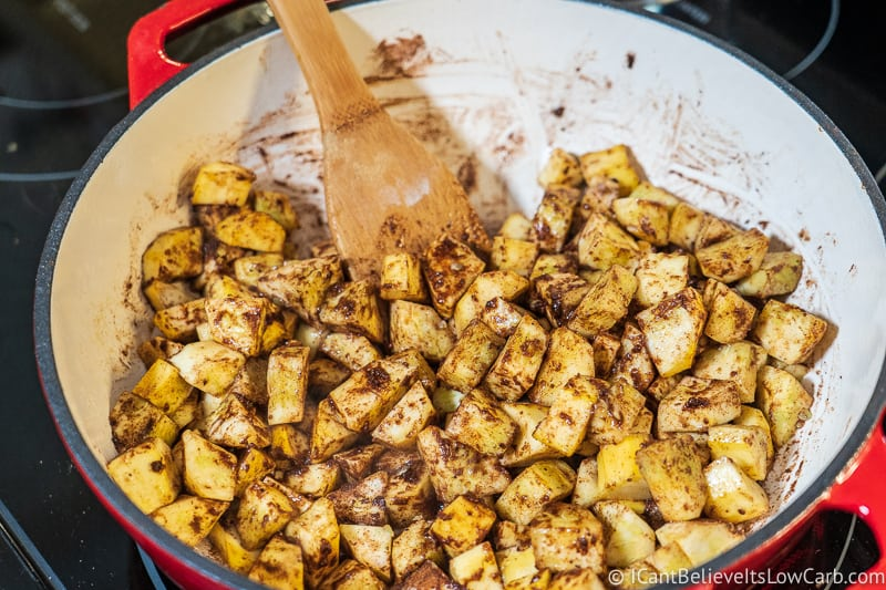stirring squash in Keto Apple Pie filling