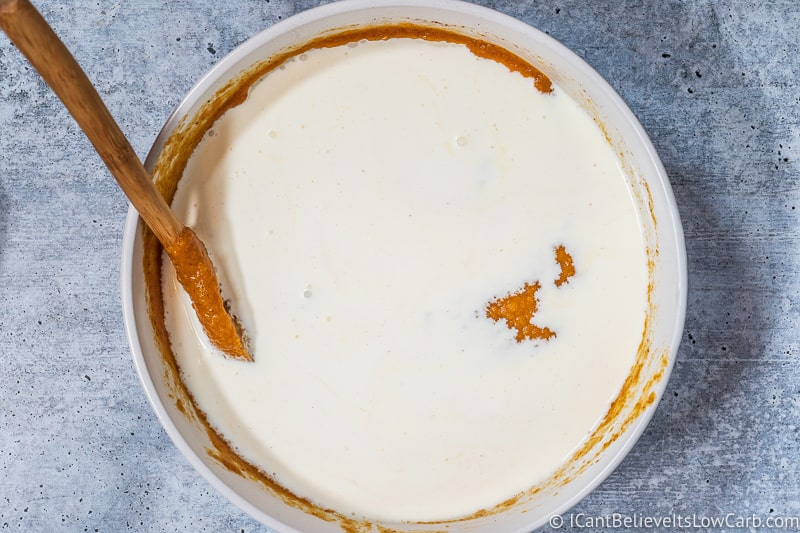 adding cream to Keto Pumpkin Pie Recipe