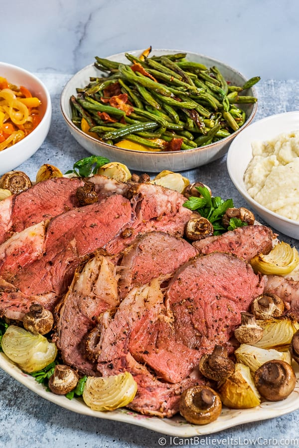 serving roasted Prime Rib on tray