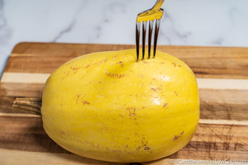 poking holes in spaghetti squash with fork to put in microwave