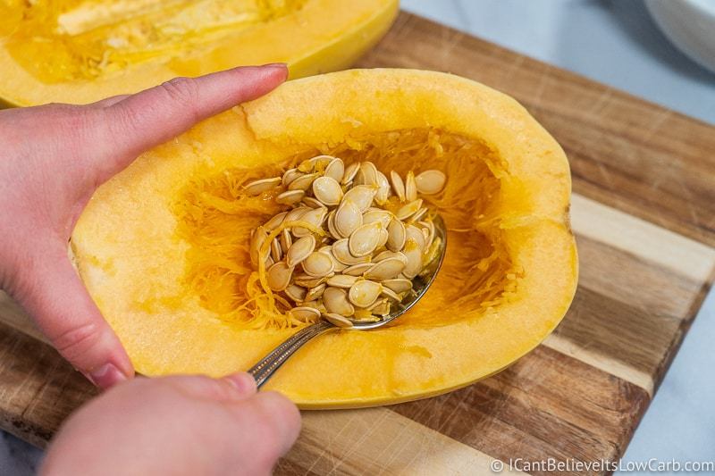 scooping out Spaghetti Squash seeds
