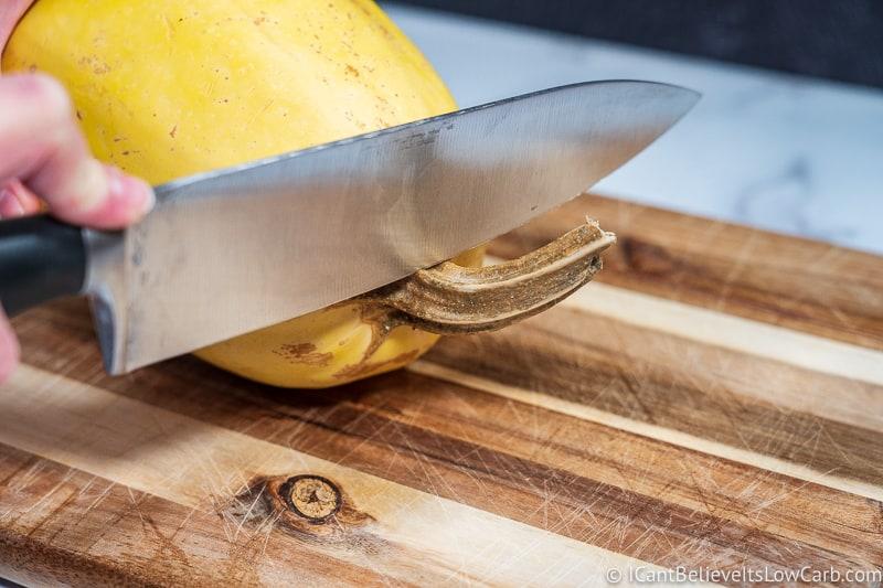 chopping the stem of a Spaghetti Squash