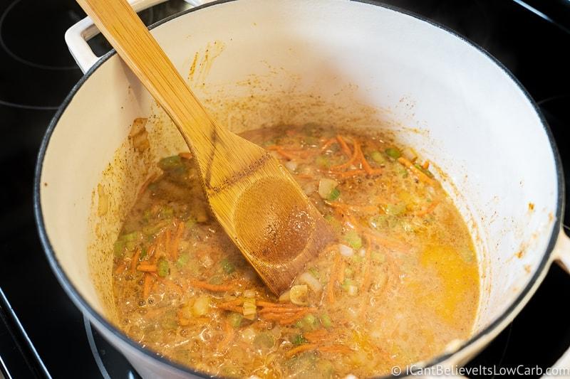 stirring Broccoli Cheddar Soup to prepare