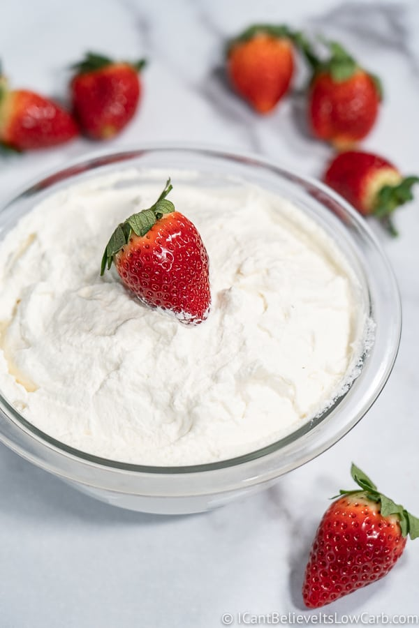bowl of sugar free Keto Whipped Cream and strawberries