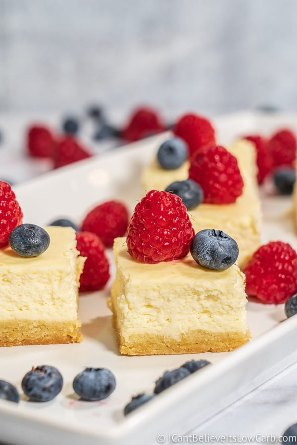 Keto Cheesecake Bars with blueberries and raspberries