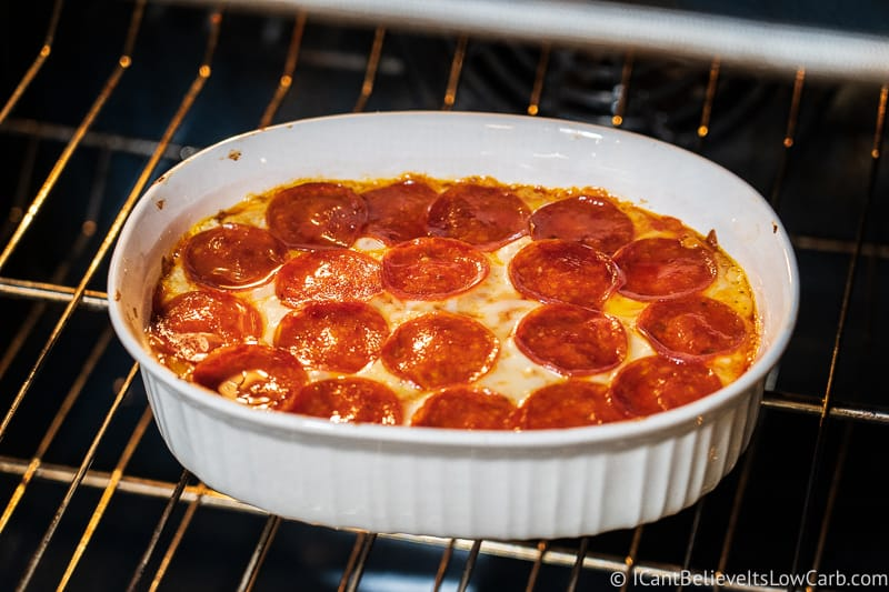 Keto Pepperoni Pizza Dip baking in the oven