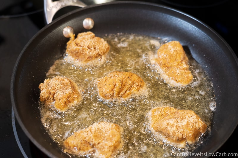 frying Keto Chicken Nuggets in a pan