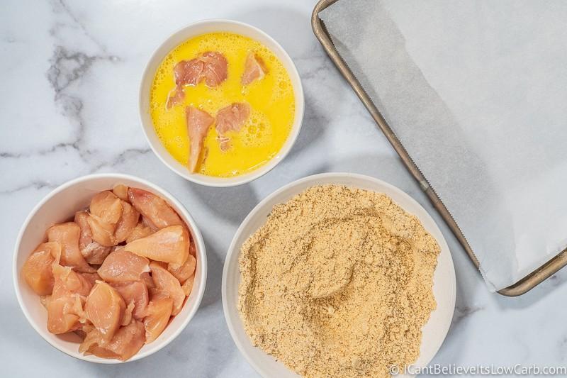 breading chicken for Keto Chicken Nuggets