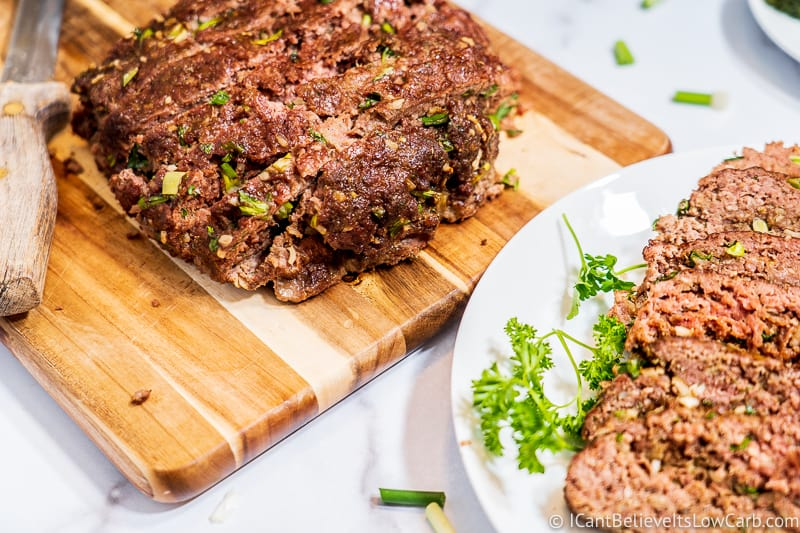 Keto Meatloaf on cutting board and plate