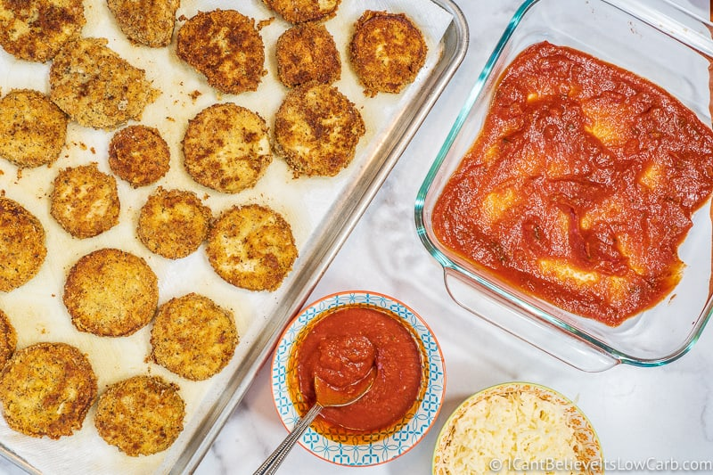 tomato sauce in baking dish for low carb Keto Eggplant Parmesan