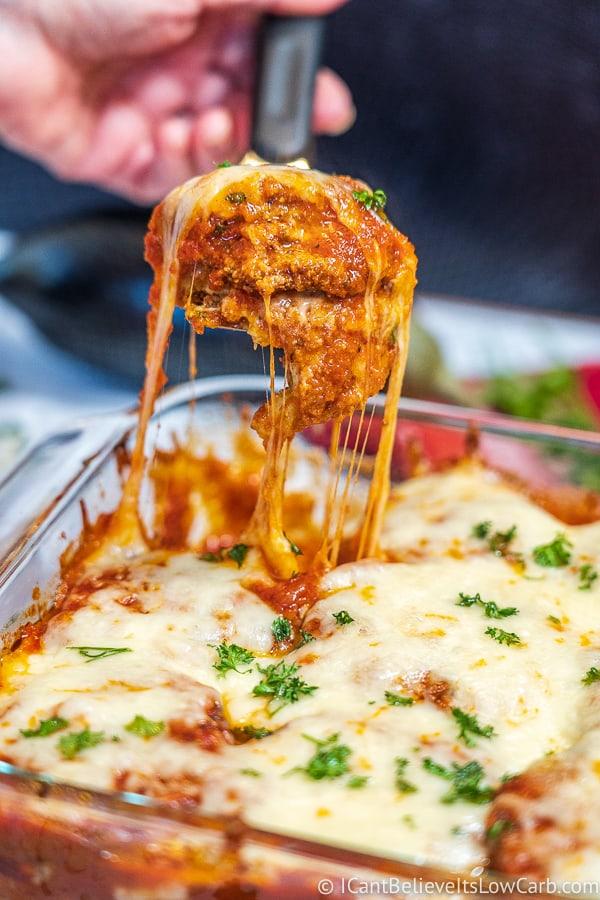 serving Keto Eggplant Parmesan with stringy mozzarella cheese