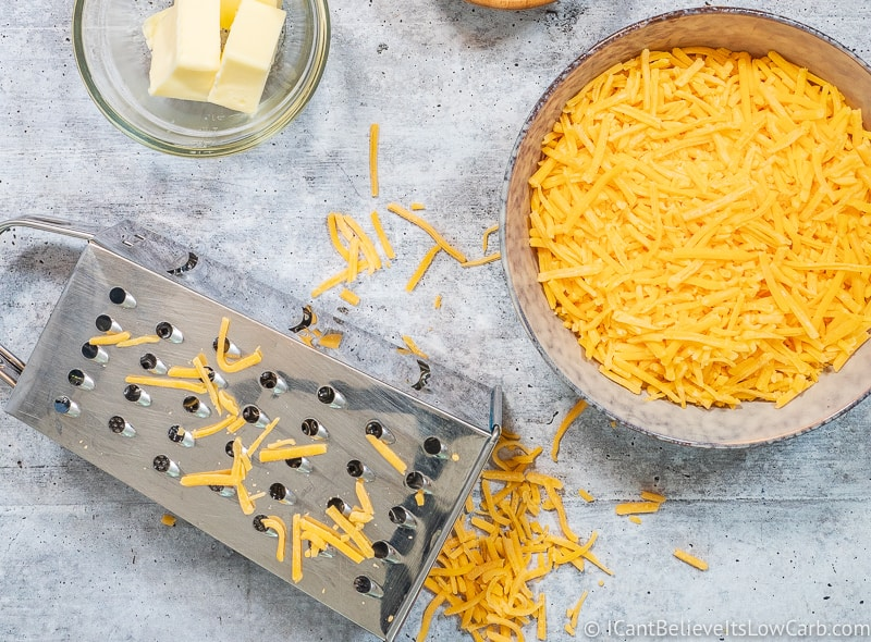 grating cheddar cheese for Keto cheese sauce