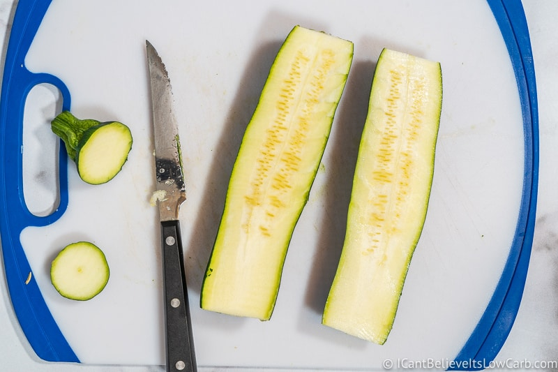 slicing zucchini on a cutting board