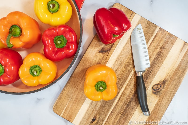 Bell peppers on cutting board with knife