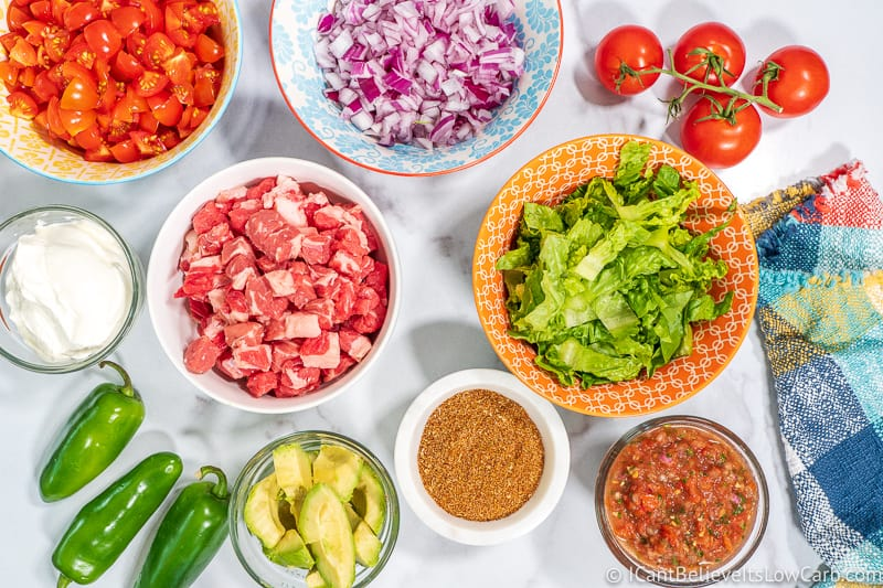 Keto Taco Ingredients on table meat lettuce and tomatoes