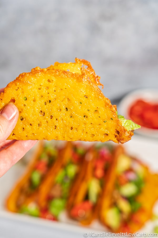 Low Carb cheese Taco shell being held in the air