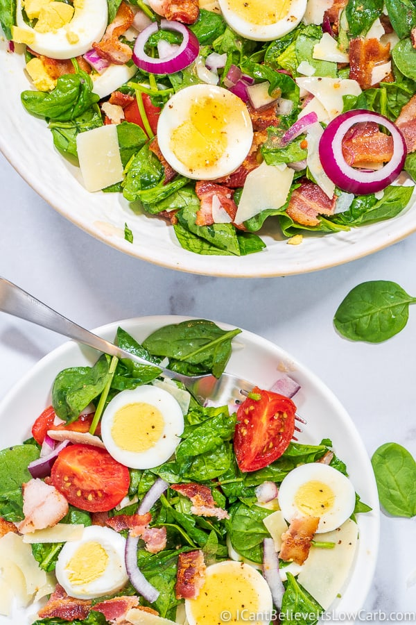 two bowls of Spinach Salad with bacon
