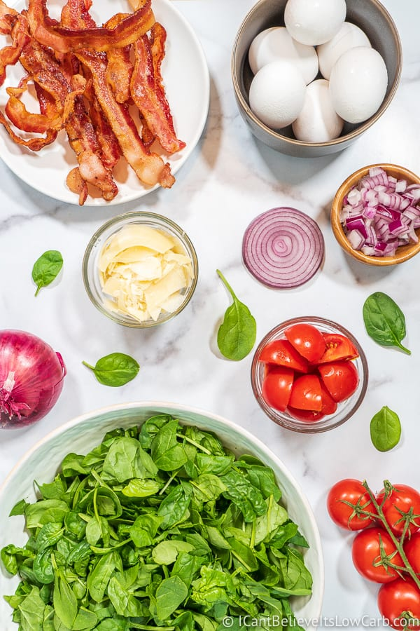 Spinach Salad ingredients with eggs and bacon