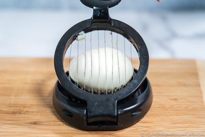 slicing a hard-boiled egg