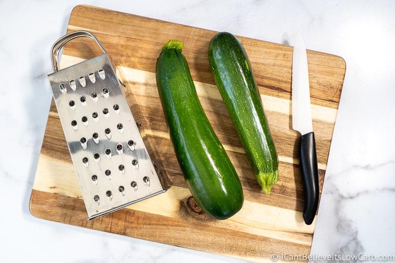 getting ready to shred zucchini on cutting board
