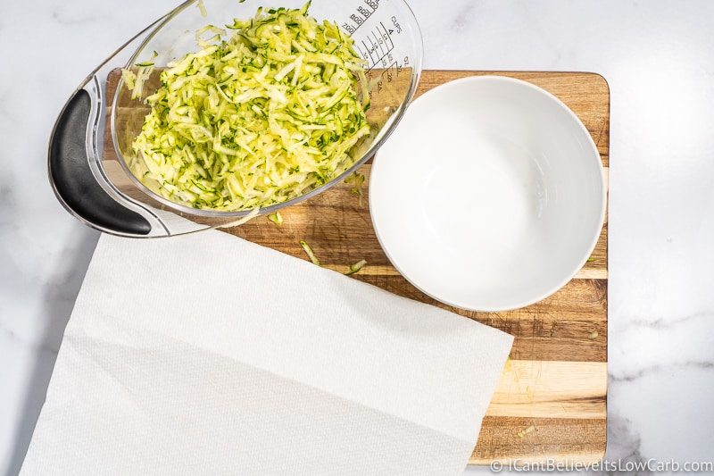 grated Zucchini for Bread in measuring cup