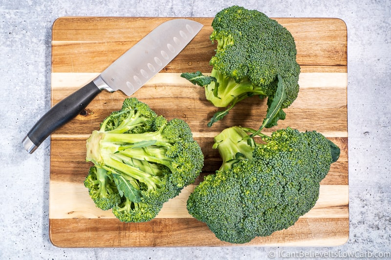 Broccoli Florets and knife on cutting board