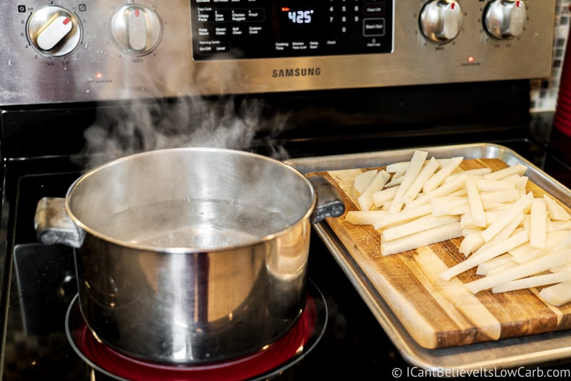 pot of boiling water on stove with cut Jicama Fries