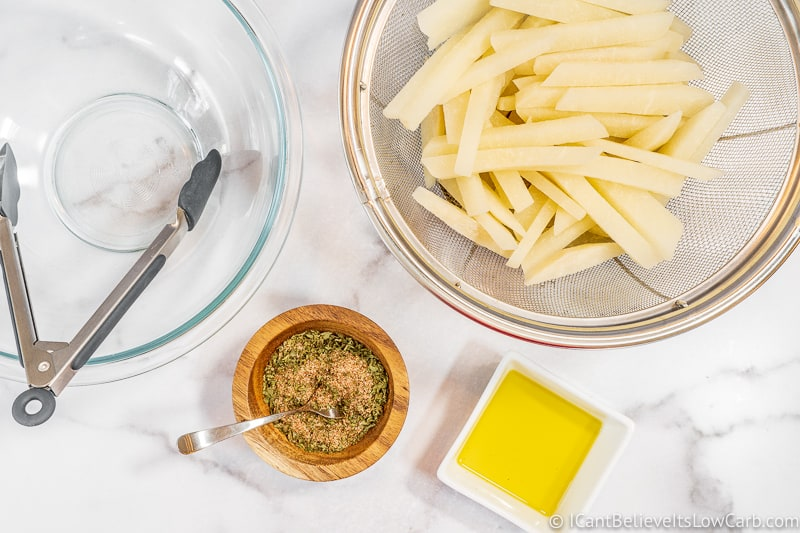 preparing Keto French Fries on table with spices and oil