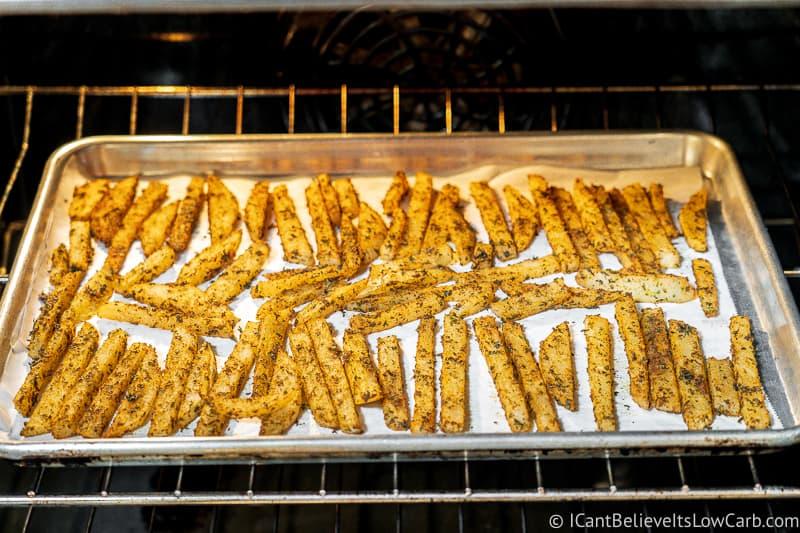 Keto Jicama Fries baking in the oven