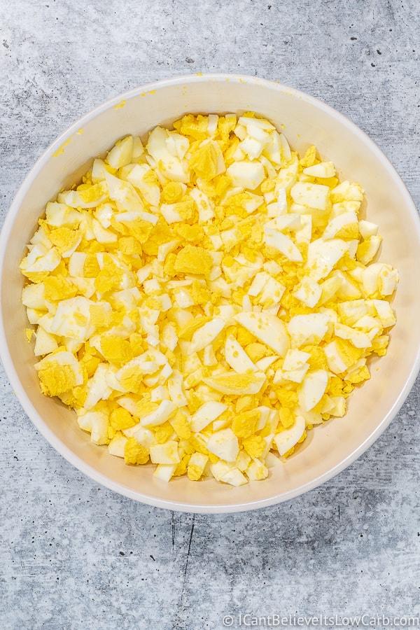 white bowl full of chopped eggs