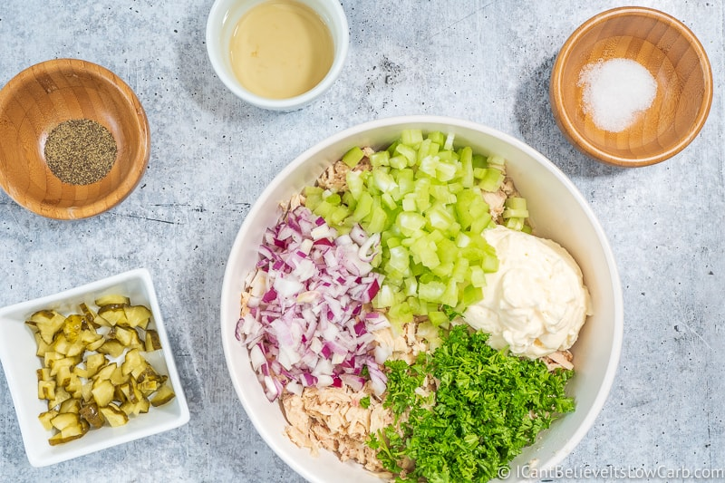 onions celery parsley and mayo in a bowl for Tuna Salad
