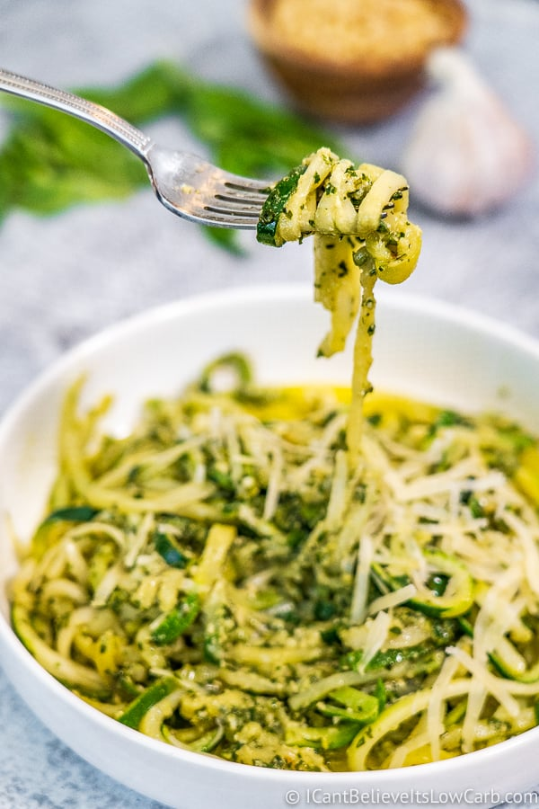 Pesto Zucchini Noodles twirled on a fork