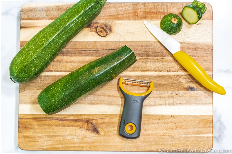 preparing Zucchini Noodles with peeler