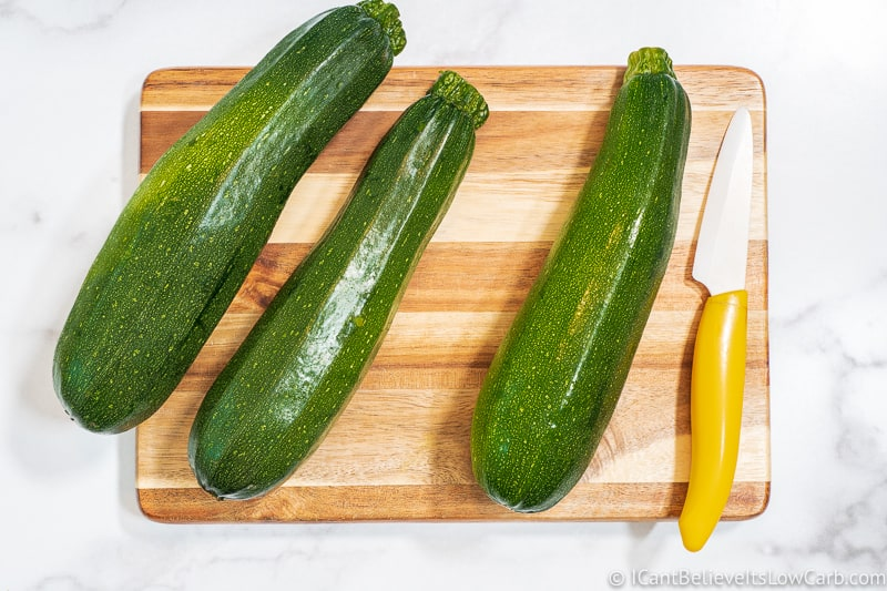3 Zucchini on a wood cutting board