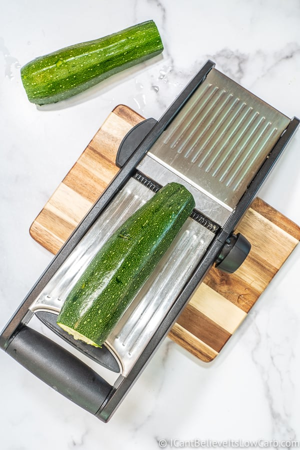 making Zucchini Noodles with mandolin slicer