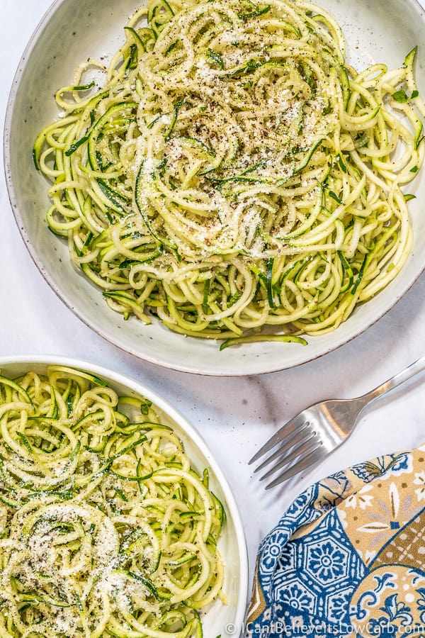 Zucchini Noodles in two bowls with parmesan cheese