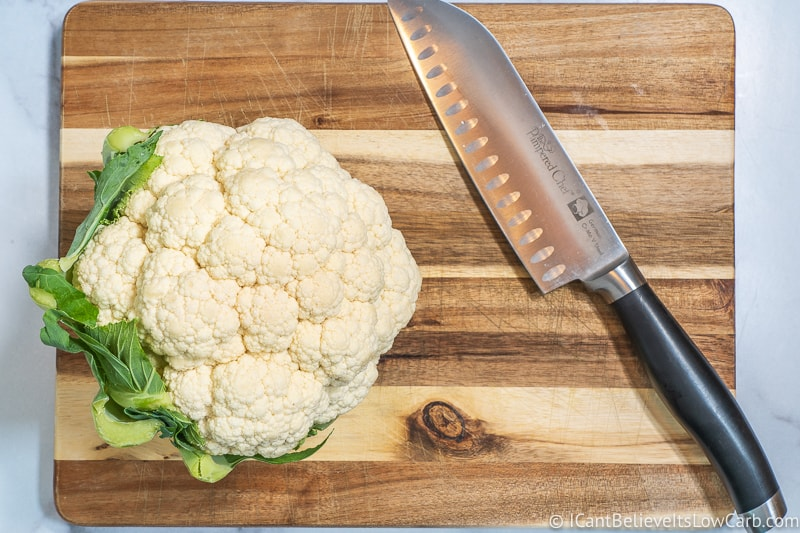 head of Cauliflower on cutting board with knife