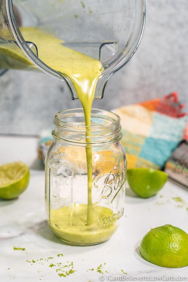pouring Cilantro Lime Dressing into a jar