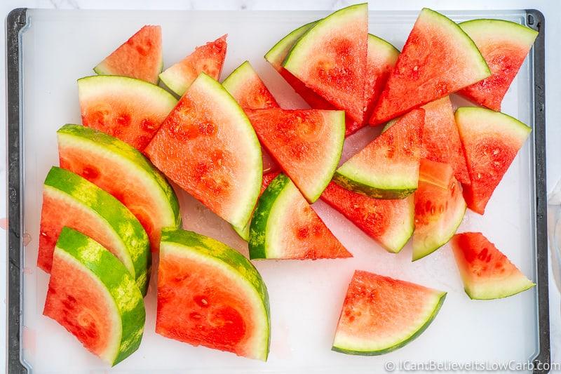 cutting board full of Watermelon triangles