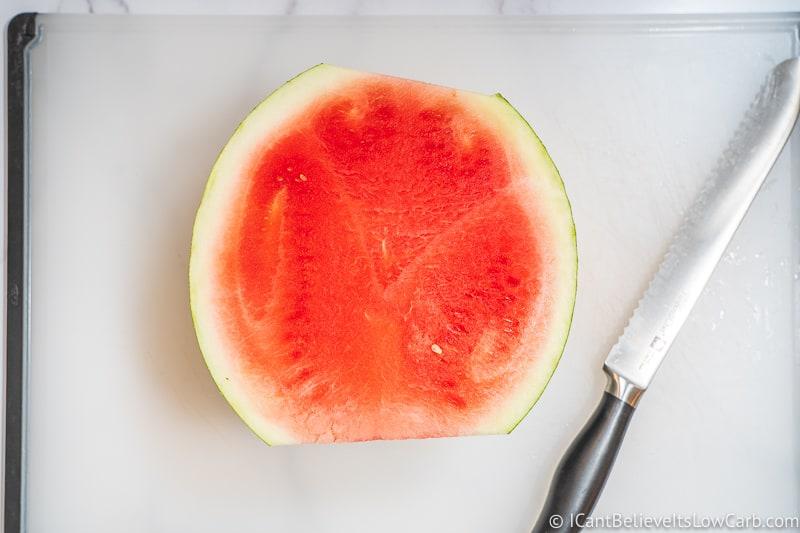 half a Watermelon on a cutting board