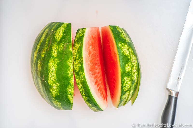 Cutting thick slices of Watermelon
