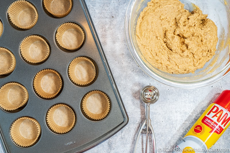 Muffin tin with liners and Keto Banana Muffin mix in bowl