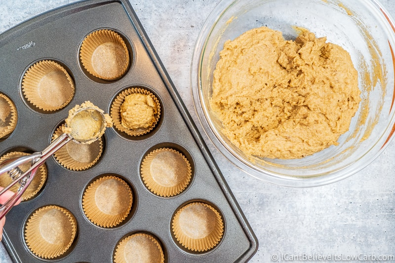 adding mix into muffin liners