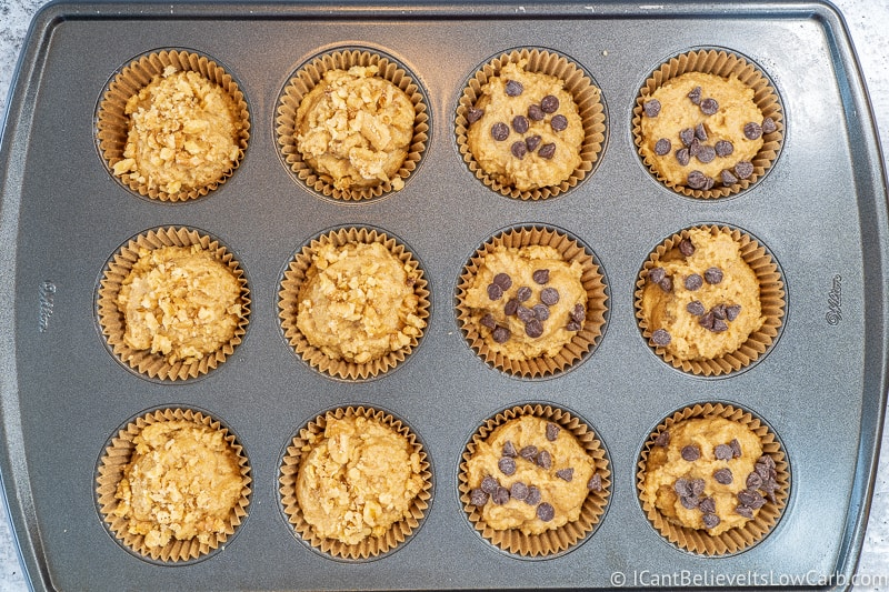 Keto Banana Muffins before baking with walnuts and chocolate chips on top